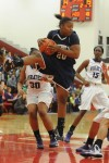 Michigan City senior guard Jameka Collins rebounds