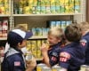 Scouts donate food and stock the shelves