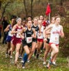 Girls runners make the first turn out of the woods