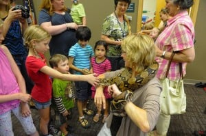 Young library patrons get up close and personal with reptiles