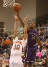 LaPorte's Miles Browder, left, and Merrillville's James Wright go after a rebound in the Class 4A Valparaiso Sectional on Wednesday.