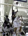Bowman Academy's Anthony Cole goes up near the rim over Carmel's Keegan Culp on Saturday night.