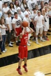 Munster's Drew Hackett makes a 3-pointer against Lowell on Friday night.