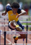 Jaelin Carter of Thornwood runs in the 110 hurdles during the Thornton Classic on Saturday.