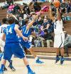 Michigan City's MiQuan Dority shoots a 3-pointer
