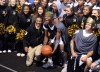 Marian basketball star Tyler Ulis, front row on left, interacts with teammate John Oliver, front row center, and other Marion students before announcing his decision to play for Kentucky at the Marian Catholic-Carmel Catholic football game.