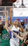 Lake Central's Chrissy Addison shoots against Valparaiso's Olivia Murray in Lake Central's 60-29 win Friday.