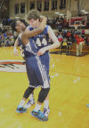 Marquette Catholic's JoVonte Peals and Ryan Fazekas rejoice in their semistate victory over Liberty Christian.