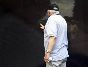 A somber honor: Honor Flight vet visits memorial bearing name of his son