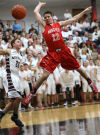 Munster's Drew Hackett is fouled by Lowell's Brandon Cory on the way to the basket Friday night.
