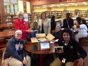 U.S. Rep. Robin Kelly donates books to Marian Catholic High School