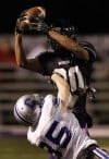 Merrillville's Ryan Neal intercepts against Carroll