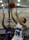Lake Central's Chrissy Addison drives for a layup past Merrillville's Jasmine Wright on Friday night.