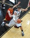 Lowell's David Stang makes a move to defend Andrean's Adam Bosak