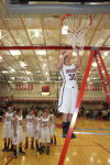 South Central's Taylor Johnson cuts the net after her team's victory over Kouts in the PCC tourney championship.