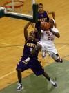 Morton's D'Jari Griffin jumps while shooting