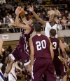Bowman Academy's Mike Ford grabs a rebound