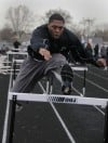 He's the defending high hurdles champ, but Marian Catholic's Erick Gavin pretends he's not