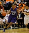 Merrillville's Darian Patton drives the lane against Warsaw during the Class 4A Valparaiso Regional championship on Saturday night.