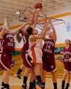 Players from both Hanover Central and Wheeler battle for a rebound during Saturday's game.
