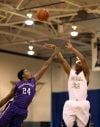 Bishop Noll's Tyreon Gates shoots over Merrillville's Diante Montgomery in the first half Friday night.
