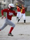 Andrean pitcher Nicole Steinbach throws a grounded ball to first base ahead