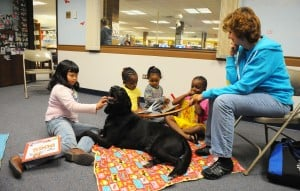 South Holland kids pause to read with four-legged friends