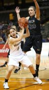 Purdue Calumet's Brooklyn Short is guarded by Oregon Tech's Karissa Dixon on Wednesday during the opening round of the NAIA Division II Tournament at the Tyson Events Center in Sioux City, Iowa.