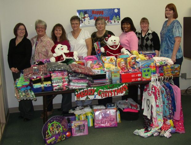 Staffers brighten Christmas for children