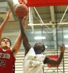 Bishop Noll's Marquis Tarver grabs a rebound away from Lake Station's Mark Novakovich during the GSSC tourney final.