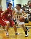 Morgan Township's Jaron Coleman drives past South Central's Rick Rigsby