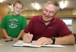 Jerry Ross signs copies of 'Spacewalker'