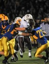 Mount Carmel running back Matt Domer takes on two Lyons Township