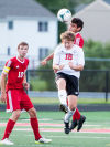 Crown Point's Scott Garcia wins the ball in the air over Portage's Joe Huber