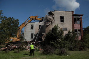 Gary building up by tearing down