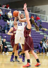 Merrillville's Riana Todd looks to shoot while Chesterton's Natalie Petro defends in the second half Friday night at the Class 4A Hobart Sectional.