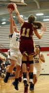 Bishop Noll's Erin Mullaney gets her lay up blocked by River Forest's Kali Winkler during the GSSC tourney championship.