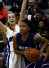 Merrillville's Erika McClinton looks to pass as Lake Central's Gina Rubino defends Friday.