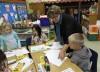 Lansing teacher offers lesson in giving