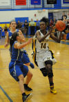 Marian Catholic's Kauai Bradley drives by Sandburg's Lauren O'Leary during Thursday's Class 4A regional title game.