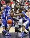 BBK_MC_REG_FINAL: Merrillville's Jelani Pruitt works for a rebound at Merrillville's basket in the first half