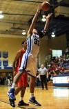 Boone Grove's Jordan Jana grabs a rebound