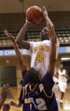 Lew Wallace's Keontae Bridges shoots over Gavit's John Freeman during Friday's Class 3A Hammond Sectional.