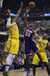 NBA ROUNDUP: George helps Pacers pull away from Lakers