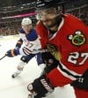 Oduya's big 'D' creates positive domino effect on Hawks