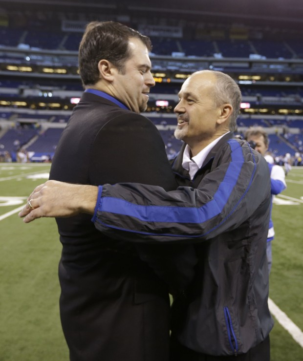 Indianapolis Colts head coach Chuck Pagano is hugged by general