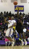 T.F. North's Jaylon Kyles's pass is tipped away by Eisenhower's Calviontae Washington in North's 79-78 win.