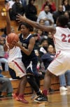 Bishop Noll's Naomi House is guarded by E.C. Central's Kaylin Palmore and Tiajaney Hawkins