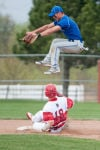 Lake Central senior infielder Johnny Gbur leaps over Portage senior Chris Klenk as Klenk slides into second base during Wednesday's game.