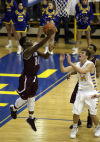 Bowman Academy guard Davon Dillard shoots in front of Carmel's Keegan Culp on Saturday.